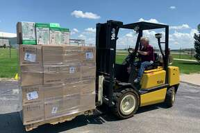 Wise Men Distillery, a Kentwood-based distillery, shipped 600 gallons of sanitizer Tuesday to United Way of Midland County to help in flood relief efforts. (Photo provided/ Wise Men Distillery)