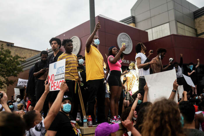 """Protesters demonstrate against the death of George Floyd outside the 3rd Precinct Police Precinct on May 26, 2020 in Minneapolis, Minnesota. Four Minneapolis police officers have been fired after a video taken by a bystander was posted on social media showing Floyd's neck being pinned to the ground by an officer as he repeatedly said, """"I can't breathe"""". Floyd was later pronounced dead while in police custody after being transported to Hennepin County Medical Center. (Photo by Stephen Maturen/Getty Images)"""