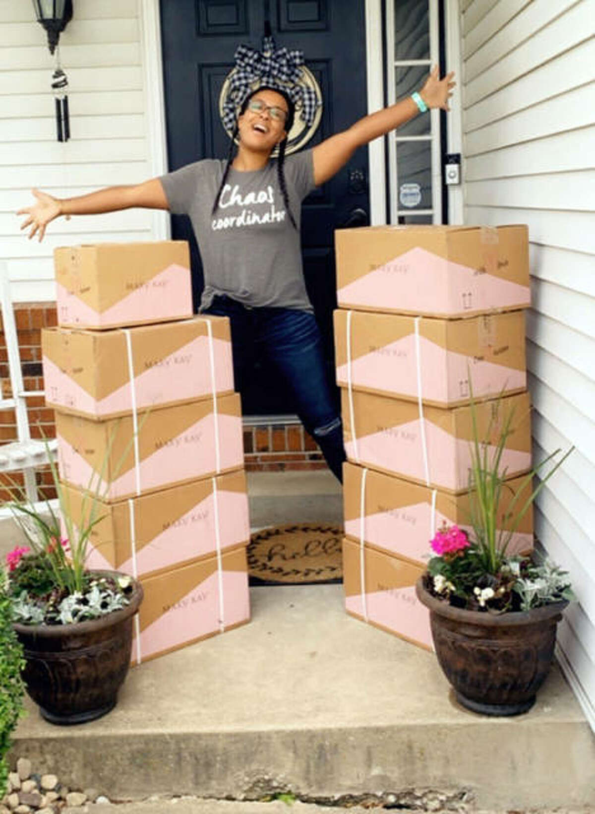 Shanyra Cox poses with the supplies she used to make 109 care packages for workers in the COVID-19 units at Christian Hospital in St. Louis and St. Anthony's Health Center in Alton.
