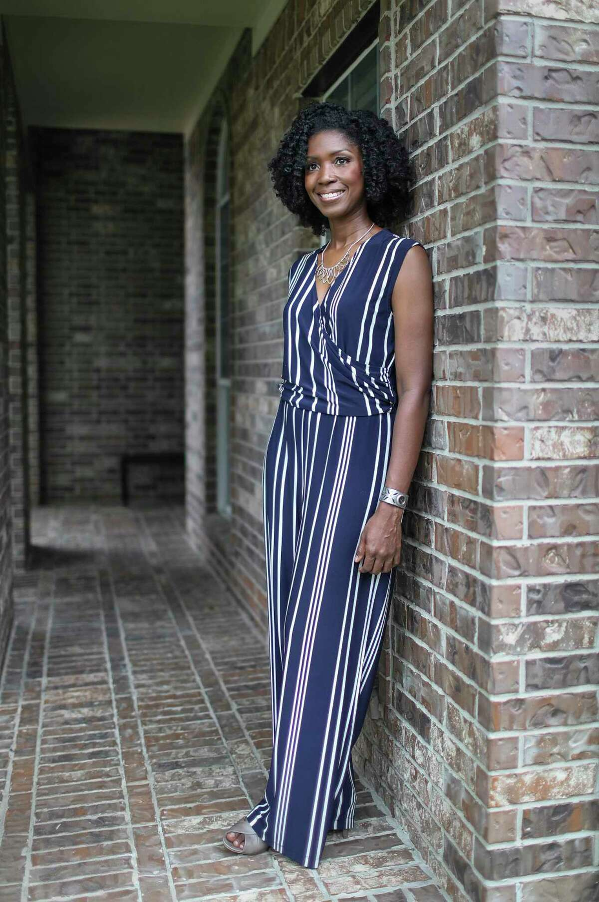 """""""I'm motivated to do the work because I believe we can prevent deaths,"""" said Rheeda Walker, Ph.D., as she posed for a portrait Thursday, May 14, 2020, at her home in Pearland. """"So, my book gives me hope."""" Walker is a professor of psychology at the University of Houston and a licensed psychologist. She wrote a book exploring mental health challenges faced by African Americans, including rising suicide rates. She said she started studying the issue in the early 1990's as suicide rates were """"increasing exponentially."""" She also described high rates of suicide for African-American children between the ages of 5 and 11."""