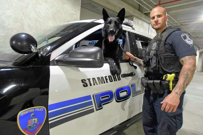 Stamford Police Officer Jonathan Gale is photographed on May 22, 2020 with his K-9 Partner Knox at police headquarters in Stamford, Connecticut. Gale has just been named Stamford Police Department's Officer of the Year for 2019.
