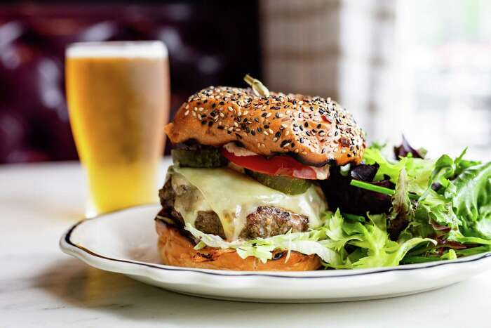 Loch Bar: River Oaks District restaurant offers its signature Loch Burgermade with Prime dry aged Angus, white cheddar, bread & butter pickles, red onion Churchill sauce, and a choice of spring salad or hand-cut French fries.