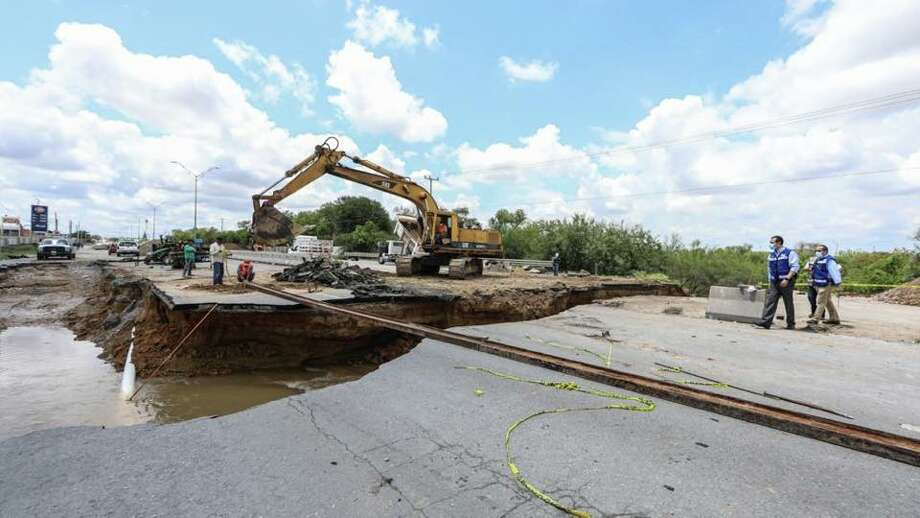 Nuevo Laredo Mayor Enrique Rivas walked the area of a sinkhole that caused the closure of Carretera Aeropuerto. Officials said the highway will be closed down for at least 2 1/2 months, prompting motorists to seek alternate routes. Photo: Courtesy