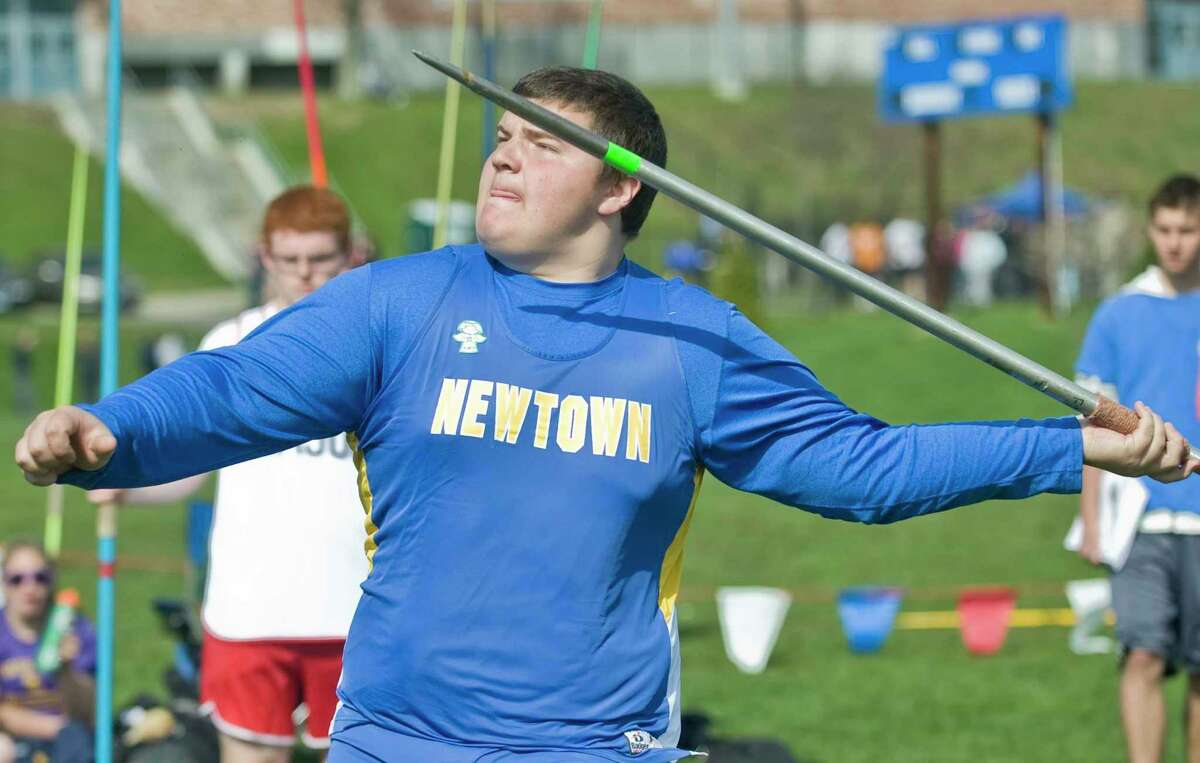 Peter Manfredonia, a sophomore at Newtown High School, throws the javalin at the O'Grady Relays track meet at Danbury High School. Saturday, April 27, 2013