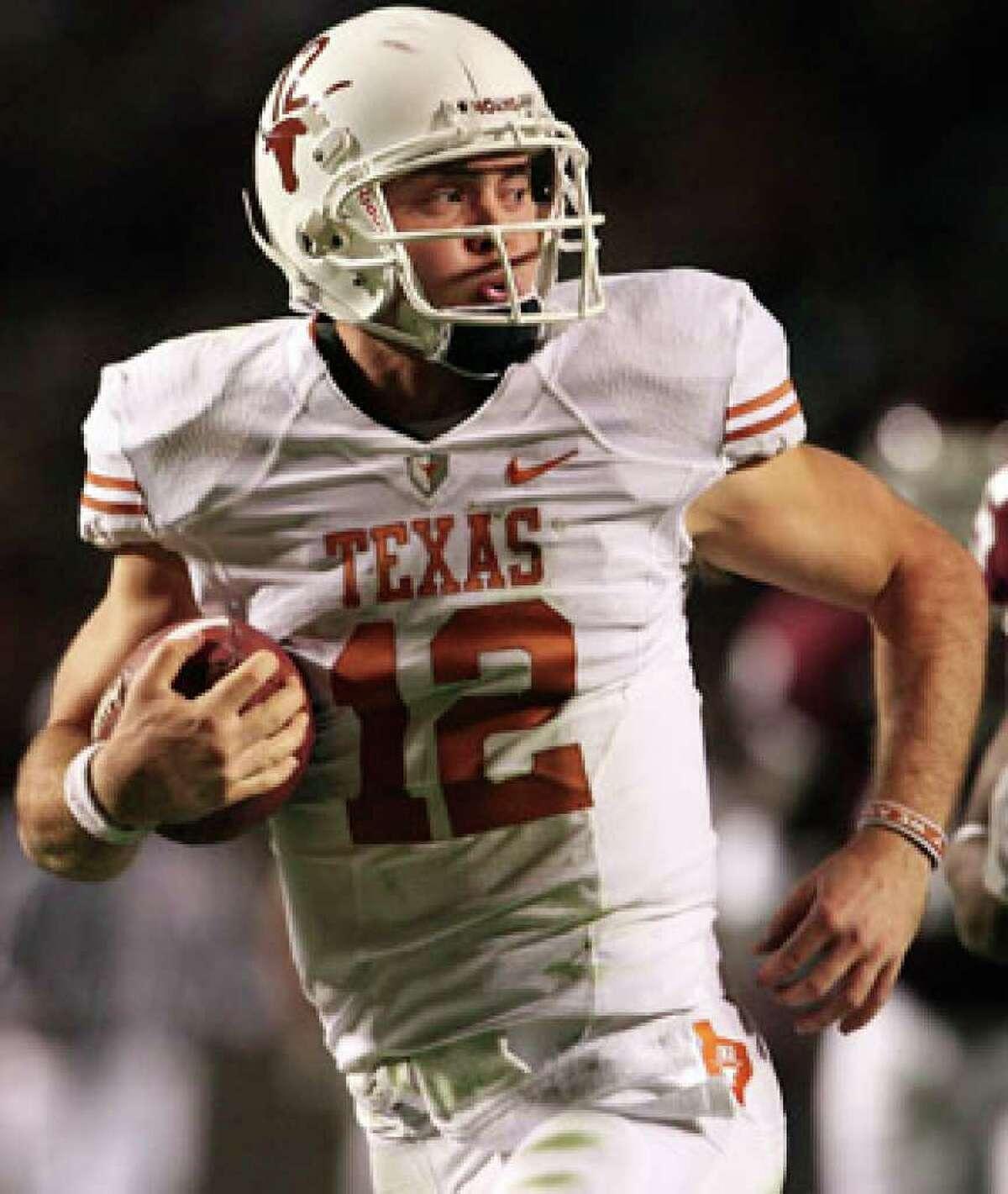 Colt McCoy runs for a touchdown against Texas A&M on Nov. 26.