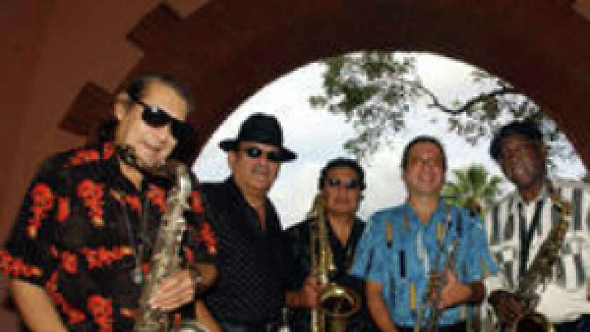 The West Side Horns in 2002 - Rocky Morales (from left), Sauce Gonzalez, Louie Bustos, Al Gomez, Spot Barnett and Jack Barber. Morales died in 2006.