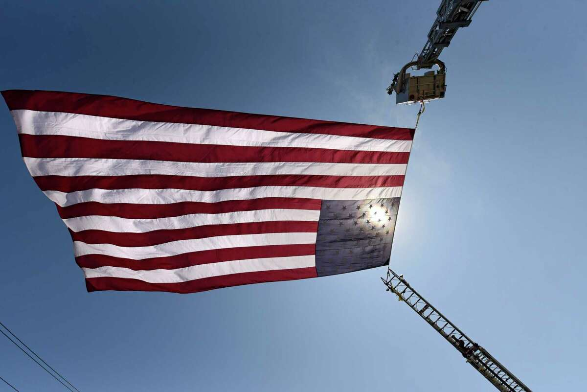 A giant American flag is seen outside of the Raymond K. LaMora Island Fire Station on Wednesday, May 27, 2020 in Cohoes, N.Y. (Lori Van Buren/Times Union)