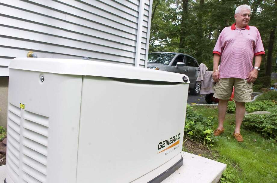 Michael Raduazzo at his home in Stamford, where he installed a generator in 2010 because of severe storms and power outages in southwestern Fairfield County. Photo: Kathleen O'Rourke / Stamford Advocate