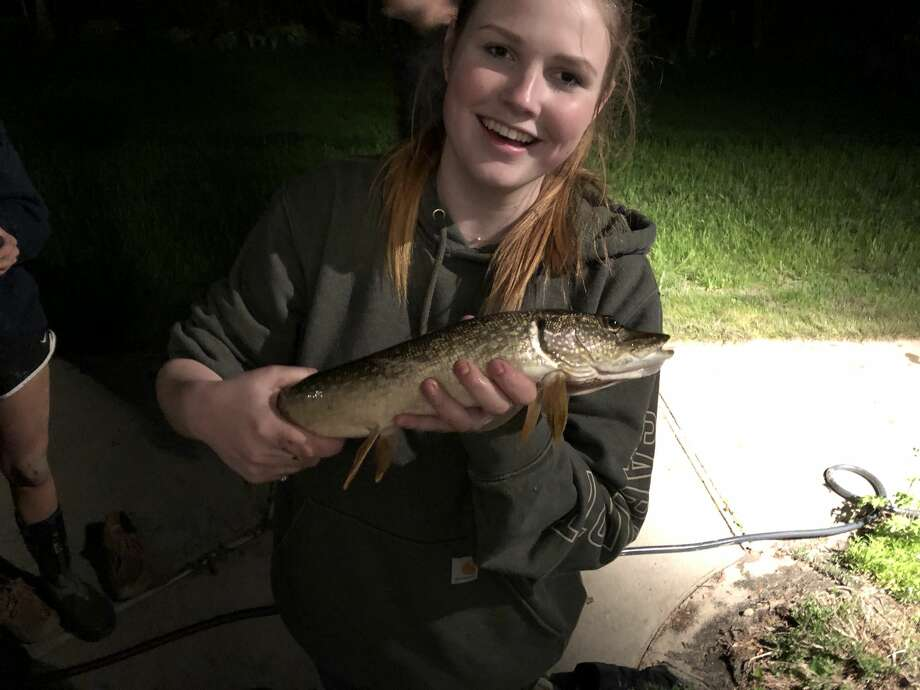 Jordan Beers displays the pike she caught in her grandparents' basement last week. Photo: Photo Provided