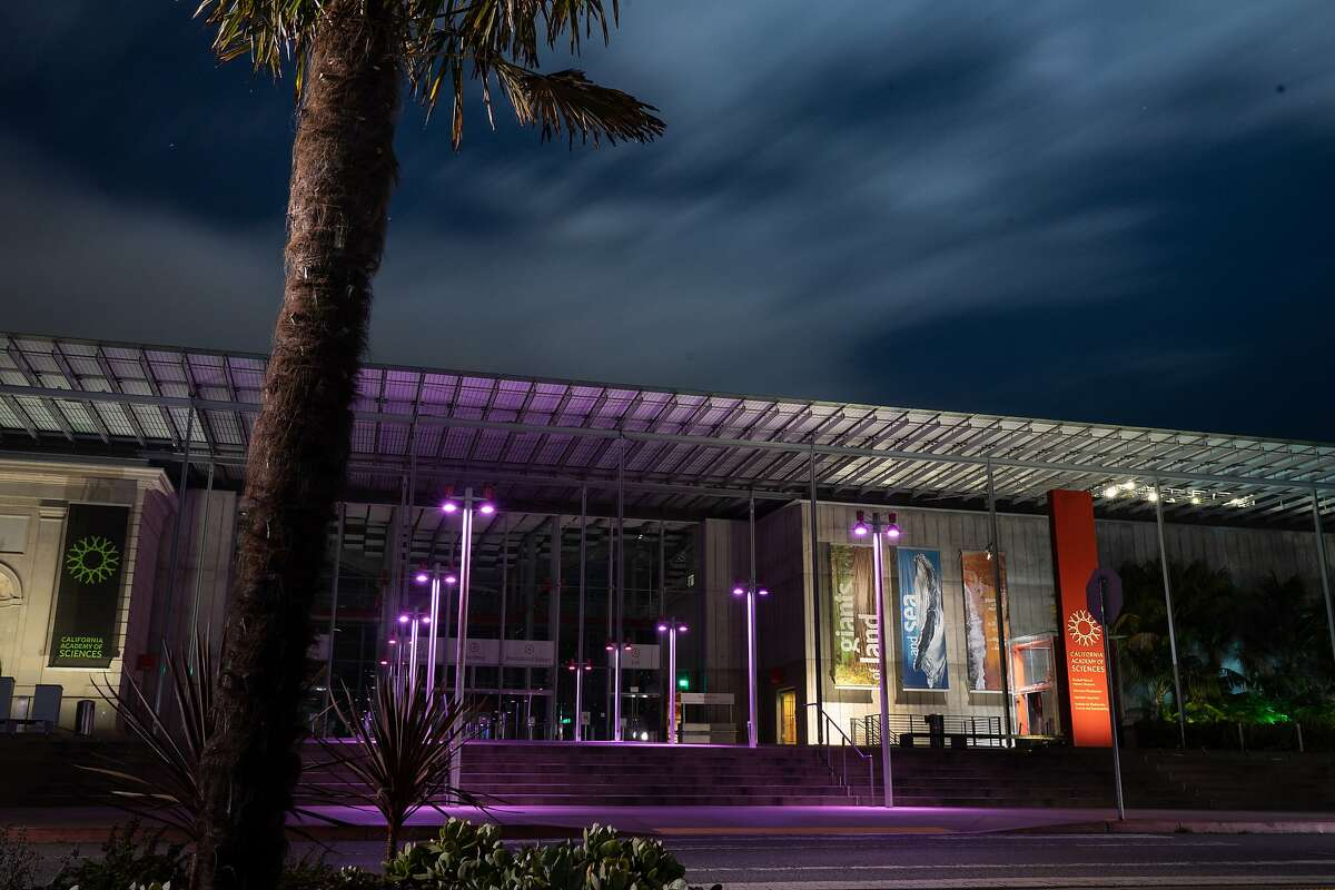 California Academy of Sciences is lighted up in purple to honor hospitalityity workers on Tuesday, April 7, 2020, in San Francisco, Calif.