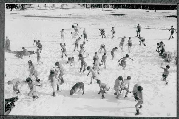 Boys and girls play in the snow while scantily clad at theUndercliff Sanatorium in Meriden.