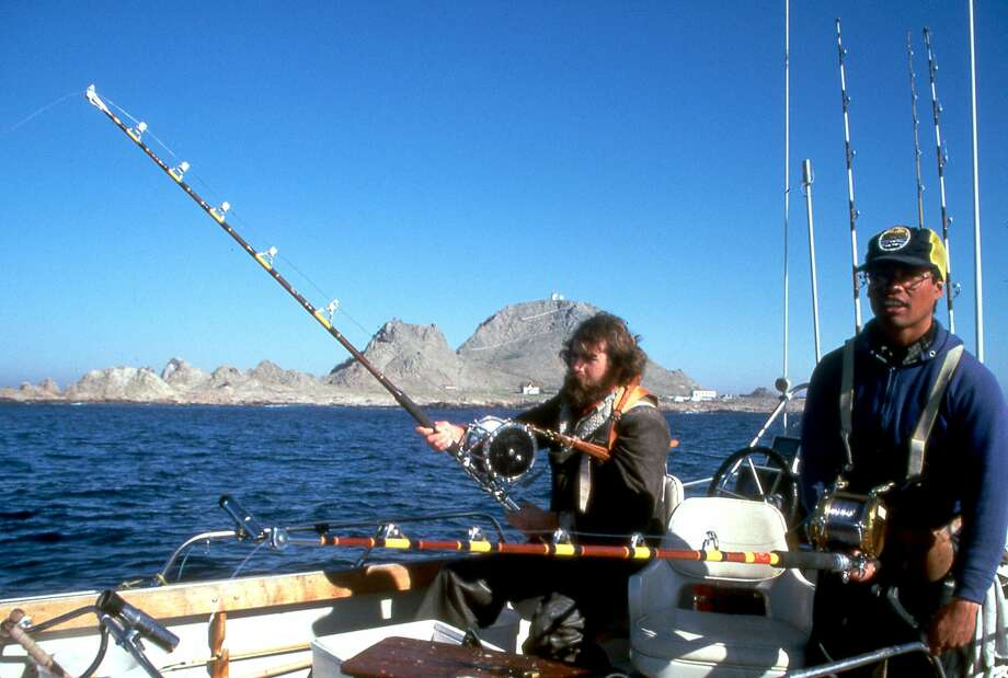 Chronicle outdoors writer Tom Stienstra with pal Angelo Cuanang catch-and-release fishing for great white sharks at the Farallon Islands -- fishing for great whites was later banned. Photo: Abe Cuanang / Abe Cuanang / Special To The Chronicle