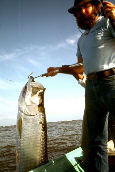 Chronicle outdoors writer Tom Stienstra with a big tarpon he caught and released in Costa Rica, the day before helping three turncoat Sandinistas escape from neighboring Nicaragua. Photo: Charlie Meyers / Charlie Meyers / Special To The Chronicle