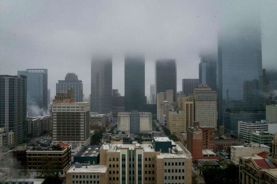 Downtown Houston shrouded in fog. The city fared poorly in a Urban Institute study of how well they include low-income and minority residents in the city's economic prosperity. Out of 274 cities measured in the index, Houston was second to last.