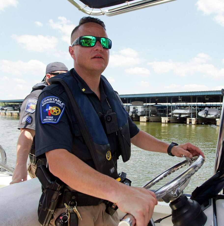 Lt. Tim Cade, of Montgomery County Precinct 1's lake patrol division, tours Stow-A-Way Marina on Labor Day, Monday, Sept. 2, 2019, in Conroe. Photo: Jason Fochtman, Houston Chronicle / Staff Photographer / Houston Chronicle