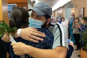Rodney Davis, 21, is released from St. Vincent's Medical Center, Bridgeport, on May 3, 2020. He was the hospital's first COVID-19 patient.
