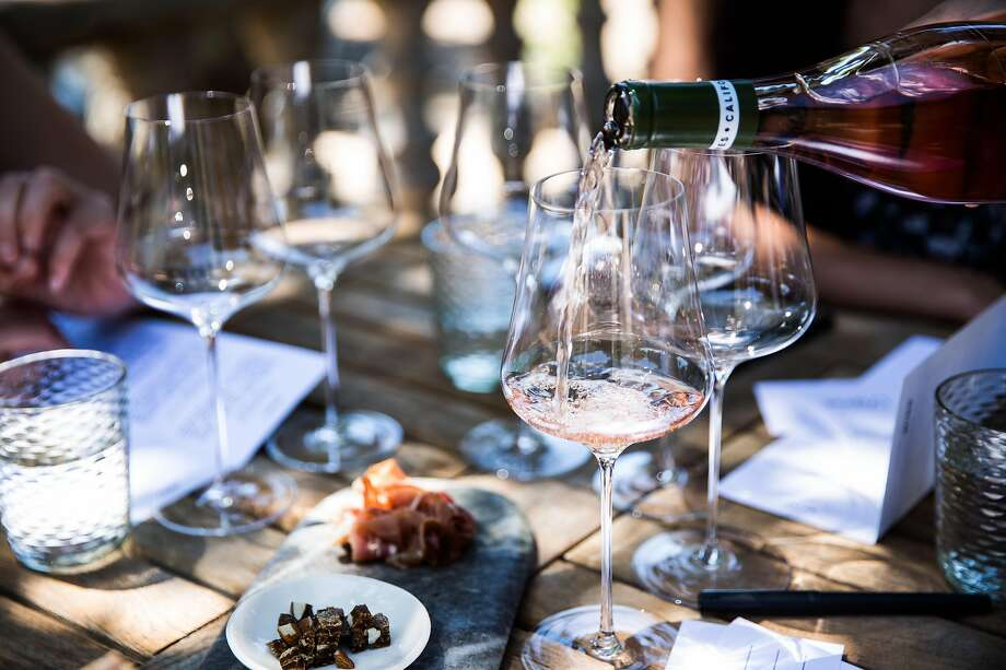Wine is poured during a tasting at Reeve Winery in Healdsburg, California on June 29, 2017. Photo: Max Whittaker / Special To The Chronicle 2017