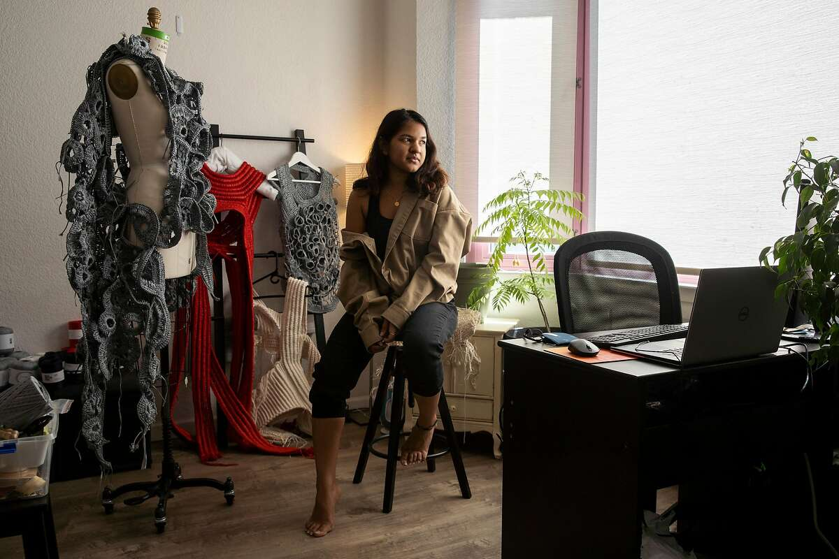 Aishwarya Gajare knits at her home on Tuesday, May 26, 2020, in San Francisco, Calif. Gajare is a knitwear design student at the Academy of Art University. The school's runway show was rescheduled, amid the coronavirus pandemic.
