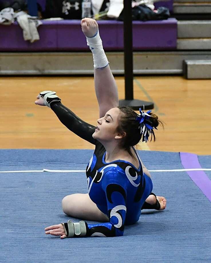 Darien's Lauren Grandon showcases her skills on floor during the CIAC Class M gymnastics championship meet at Johnathan Law in Milford on Saturday, Feb. 29, 2020. Photo: Brenda McDermott / Contributed / CMG