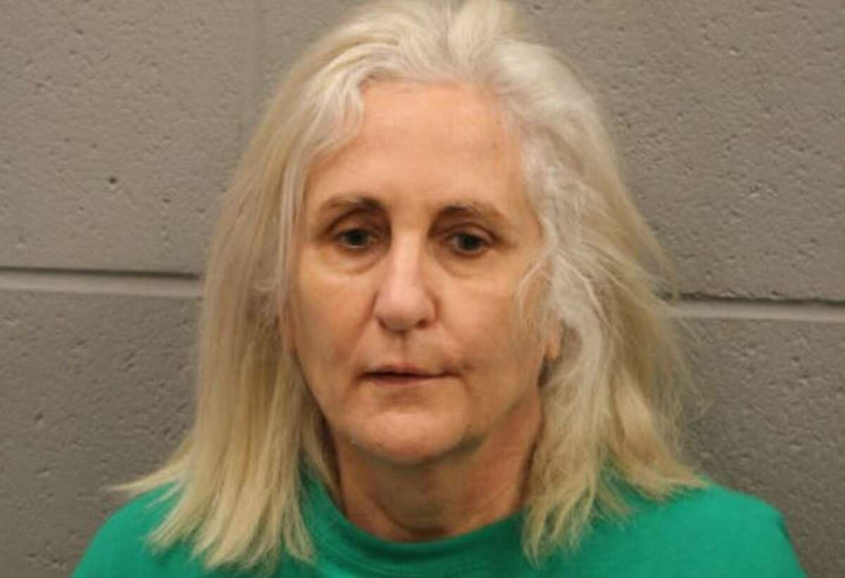 Constance Bono, 61, was charged with aggravated assault with a deadly weapon in an incident where she is accused of waving a hammer at a couple and using hateful language toward them.
