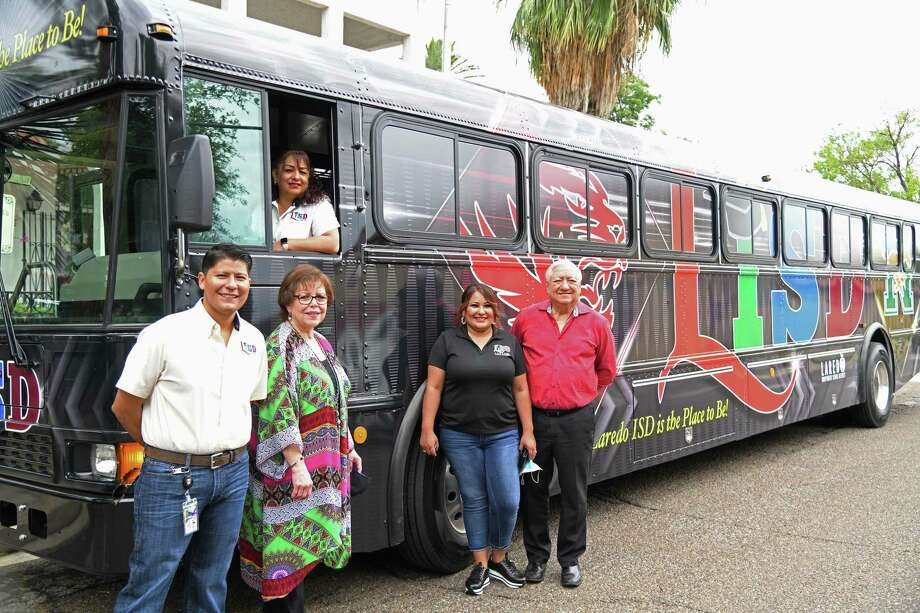 New LISD transit buses arrived on Tuesday after a $1.5 million investment made by the district before the pandemic. LISD staff and board members are pictured including Esteban Rangel, Dr. Sylvia Rios, Delia Flores, Monica Garcia and Hector Noyola. Photo: Christian Alejandro Ocampo / Laredo Morning Times / Laredo Morning Times