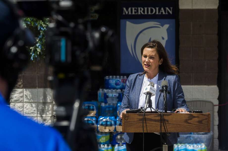Gov. Gretchen Whitmer addresses members of the media, volunteers and community members during a press conference on flood recovery efforts Wednesday, May 27, 2020 at a donation center at Meridian Elementary in Sanford. (Katy Kildee/kkildee@mdn.net) Photo: (Katy Kildee/kkildee@mdn.net)