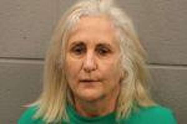 Constance Bono, 61, was charged with aggravated assault with a deadly weapon after an incident where she reportedly waved a hammer at a couple and used hateful language toward them.