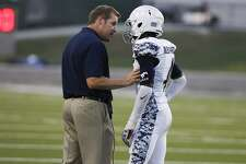 Lamar Consolidated head coach Rick LaFavers has a conversation with defensive back Bryce Malone as the Mustangs took on Westside in the first game of the season at Delmar Stadium on August 27, 2015.