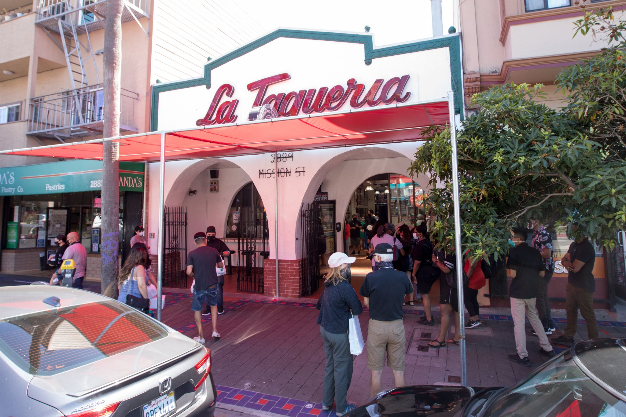 La Taqueria customers welcome back an old SF friend, with new rules