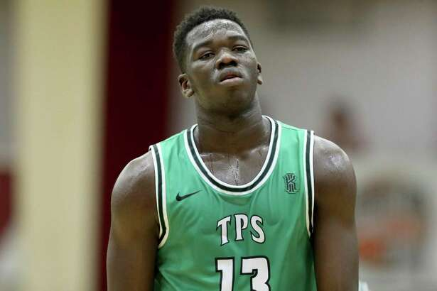 The Patrick School's Adama Sanogo #13 is seen against IMG Academy during a high school basketball game at the Hoophall Classic, Saturday, January 18, 2020, in Springfield, MA. (AP Photo/Gregory Payan)