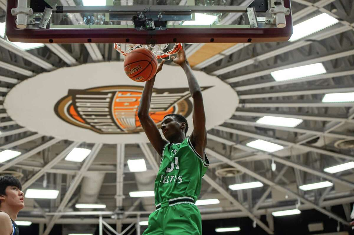 SPRINGFIELD, MA - JANUARY 18: Patrick School Celtics forward Samson Johnson (34) dunks the ball during the second half of the Spalding Hoophall Classic high school basketball game between the Patrick School Celtics and IMG Academy Ascenders on January 18, 2020 at Blake Arena in Springfield, MA (Photo by John Jones/Icon Sportswire via Getty Images)