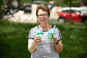 An effort organized by 2|42 Community Church provides Midland residents working to clean up flood-damaged homes with cleaning supplies, gloves, water, and hot meals from the Makin' Bacon food truck Wednesday, May 27, 2020. (Adam Ferman/for the Daily News)