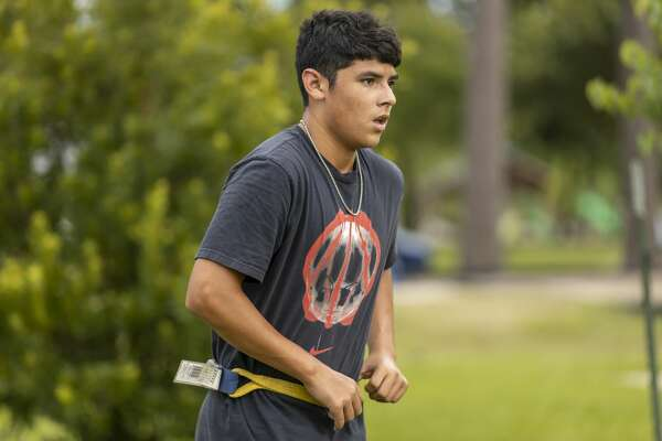 Michael Rios Jr. secures his belt during training at Candy Cane Park in Conroe, Wednesday, May 27, 2020. Michael Rios Jr. has been playing football since he was 4-years-old.