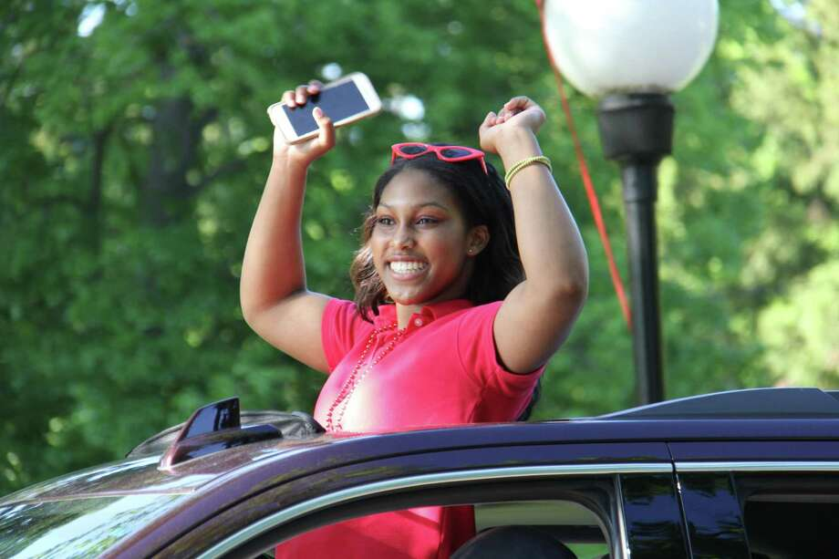 Greenwich Academy's seniors graduated on Monday. Students were driven through the school's traffic circle by family members, while faculty waved on from the driveway. They got out one by one to receive their diploma and pose for two pictures, including one with a cutout of their head of school, Molly King. Photo: Contributed