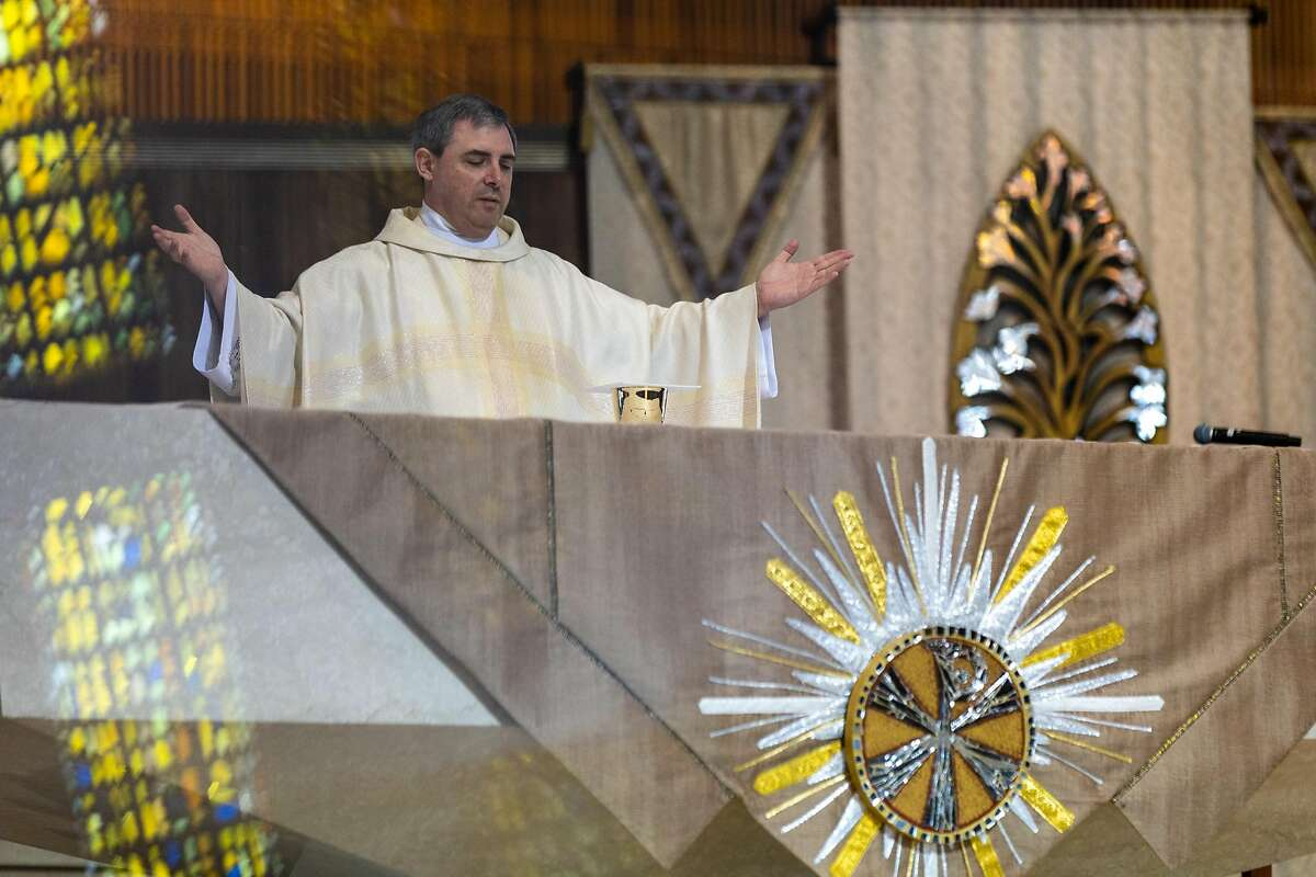 Father Bill Nicholas celebrates a livestream mass at the Cathedral of Saint Mary on Wednesday, May 27, 2020, in San Francisco, Calif.