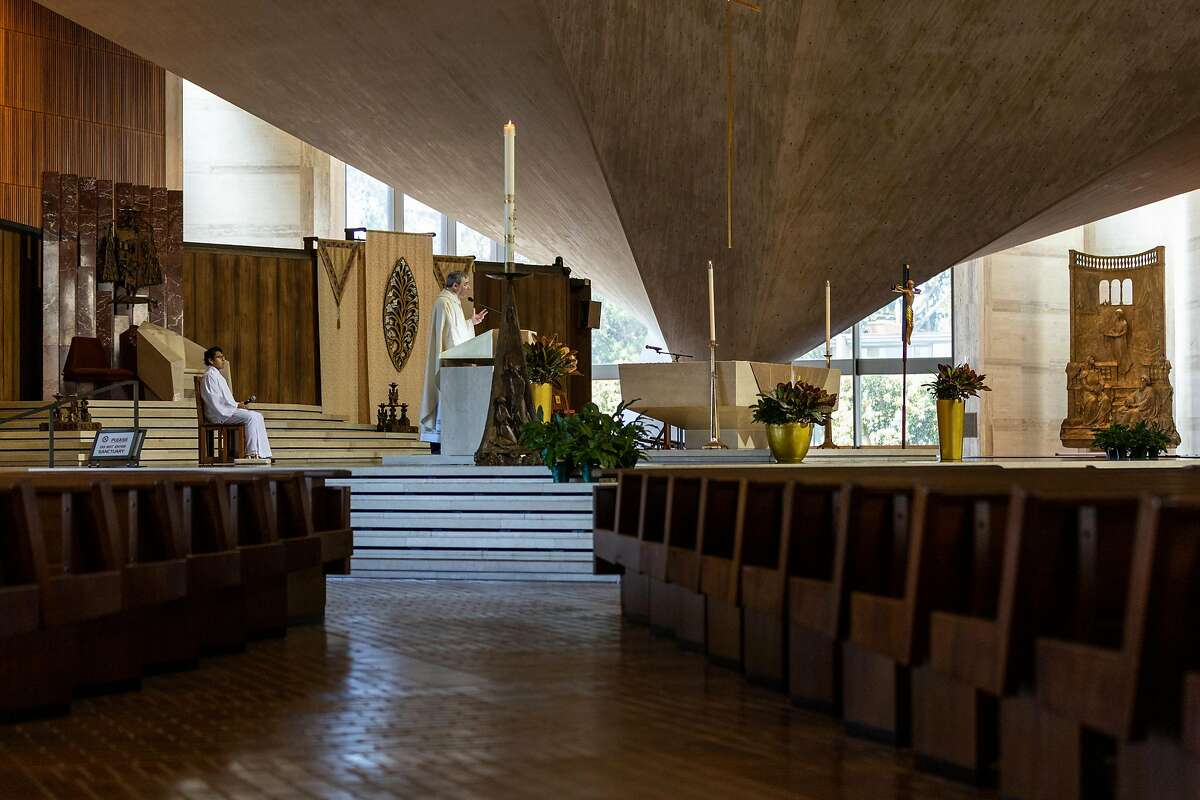 Father Bill Nicholas delivers a livestream mass in an empty Cathedral of Saint Mary on Wednesday, May 27, 2020, in San Francisco, Calif.