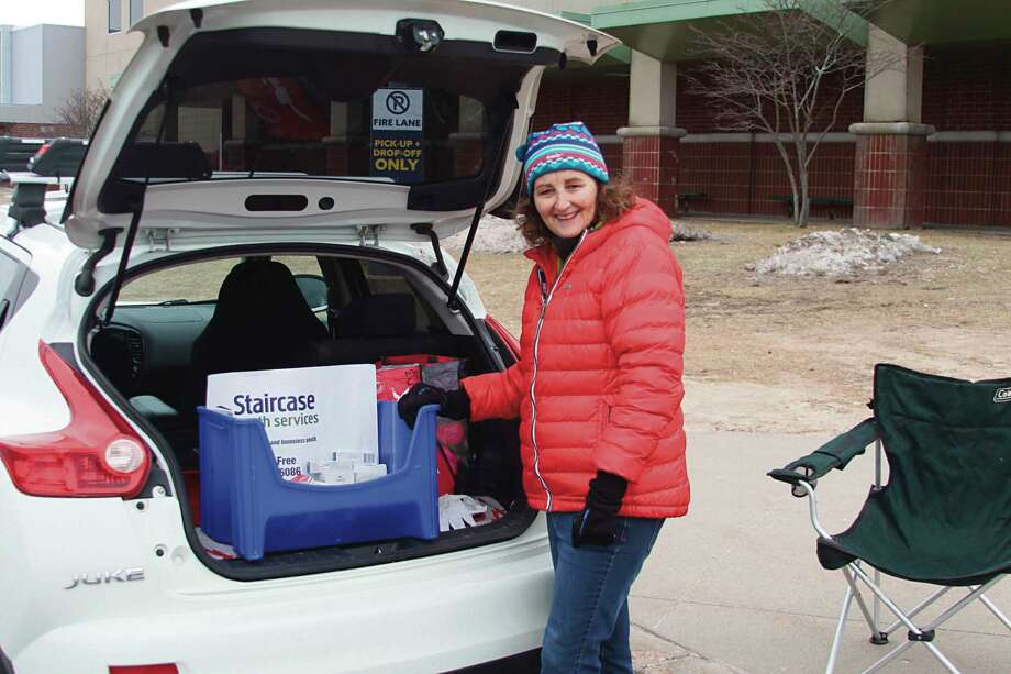 In March, Rita McCann of Staircase Youth Services handed out hygiene items at the Manistee Area Public Schools lunch location those who needed them. Staircase Youth Services received a grant from the Manistee Community Foundation's Community Response Fund to support their continued efforts to meet the ongoing need for personal hygiene items for area youth in need. (File photo)