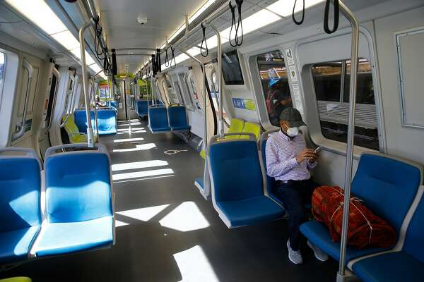It's not difficult for commuters to practice social distancing on a Richmond train stopped at the MacArthur BART station in Oakland, Calif. on Tuesday, May 26, 2020. BART may consider additional cuts as ridership and revenue continue to plummet during the coronavirus pandemic.
