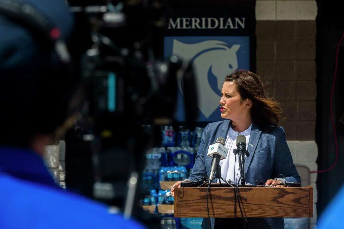 FILE - Gov. Gretchen Whitmer addresses members of the media, volunteers and community members during a press conference on flood recovery efforts at a donation center at Meridian Elementary in Sanford. (Katy Kildee/kkildee@mdn.net)