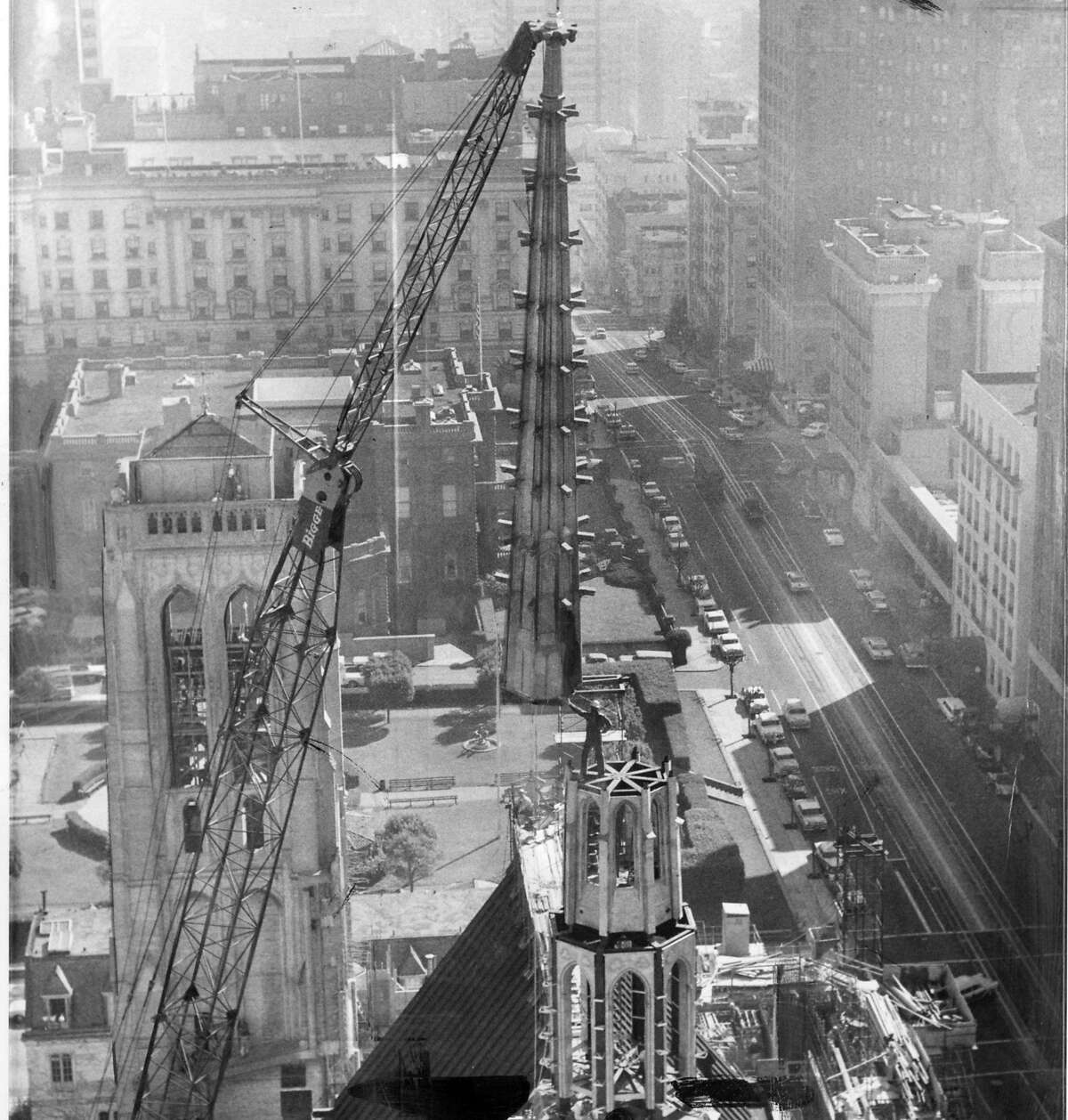 The new spire is being lifted onto Grace Cathedral, March 19, 1963 The spire weighs apron. 5 tons, and is surmounted by a gold cross that measures 17 ft. 5 inches in height Photo ran 3/20/1963, p. 1 Associated Press photo
