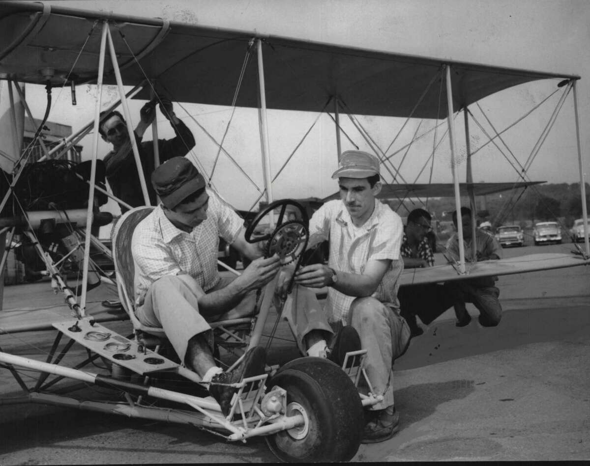 On May 28, 1959, mechanics from the O'Connor Aircraft Company assemble the replica of Glenn H. Curtiss' Albany Flyer which will be flown from Albany to New York City. The plane, a facsimile of the one Curtiss flew to New York on May 29, 1910, arrived in Albany yesterday from Seattle. The mechanics are Charles Torre, left, and Anthony Hill. The plane is scheduled to take off from Albany Airport at 7:15 a.m. tomorrow. The flight is a feature of the Hudson Champlain celebration. May 28, 1959 (Knickerbocker News Staff Photo/Times Union Archive)