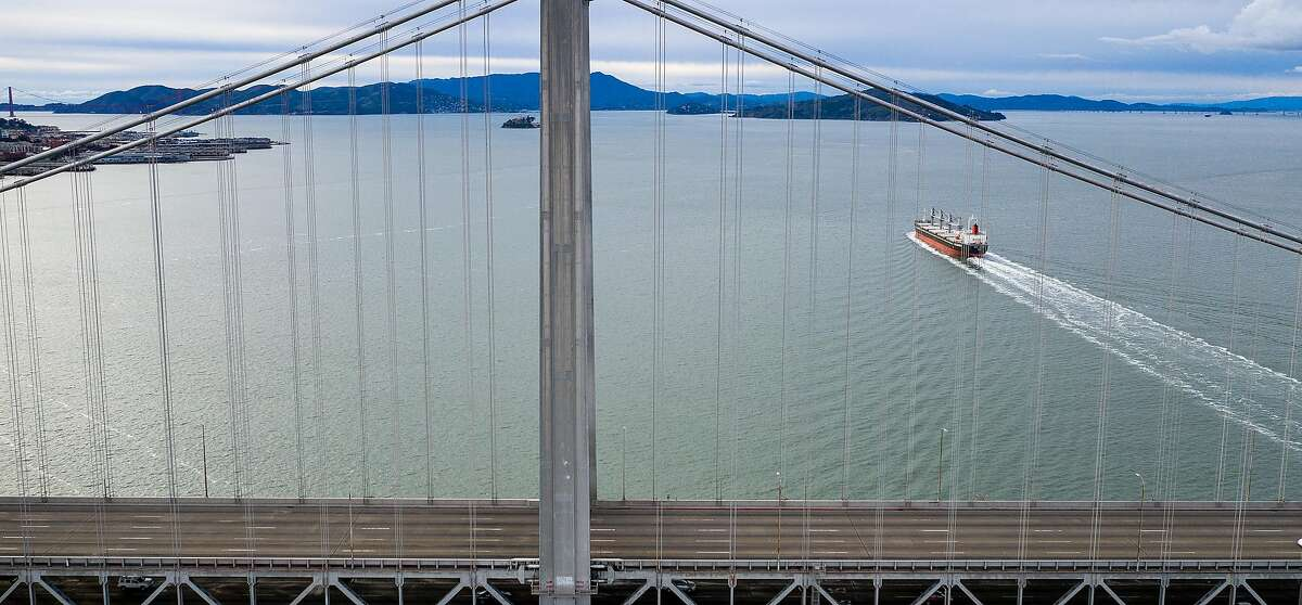 The upper deck of the Bay Bridge rests empty at 6:23 p.m. as seven Bay Area counties enter the first day of shelter-in place-orders to slow coronavirus spread on Tuesday, March 17, 2020, in San Francisco.