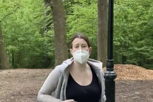 This image made from Monday, May 25, 2020, video provided by Christian Cooper shows Amy Cooper with her dog talking to Christian Cooper at Central Park in New York. A video of a verbal dispute between Amy Cooper, walking her dog off a leash and Christian Cooper, a black man bird watching in Central Park, is sparking accusations of racism. (Christian Cooper via AP)