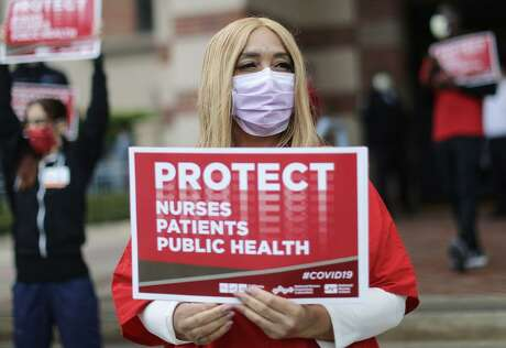 Registered nurses and health care workers protest what they say is a lack of personal protective equipment (PPE) available for frontline workers at UCLA Medical Center, Santa Monica amid the coronavirus pandemic on April 13, 2020 in Santa Monica, California. Nurses across the country have raised concerns about the lack of PPE available as the spread of COVID-19 continues.