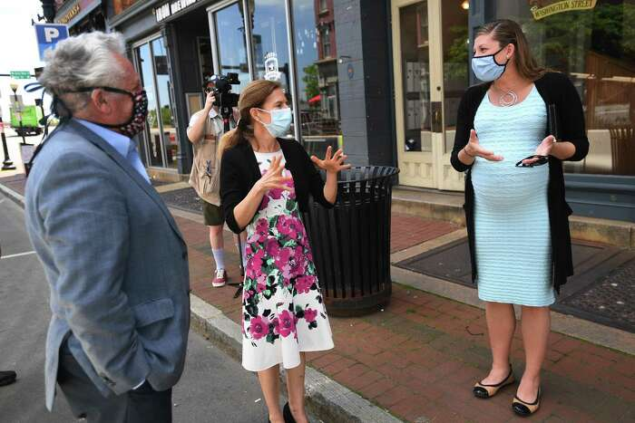 From left; Norwalk Mayor Harry Rilling, Lt. Governor Susan Bysiewicz, and Norwalk Chief of Economic Development Jessica Casey chat during a walking tour of the Washington Street retail and restaurant district in Norwalk, Conn. on Wednesday, May 27, 2020.