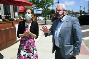 From left; Norwalk Mayor Harry Rilling, right, leads Lt. Governor Susan Bysiewicz on a walking tour of the Washington Street retail and restaurant district in Norwalk, Conn. on Wednesday, May 27, 2020.