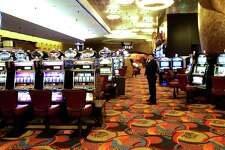 FILE - In this file photo of May 13, 2008, one of the slot machine rooms at the new MGM Grand Hotel stands ready for the start of business in Mashantucket, Ct., at the Foxwoods Resort Casino. Foxwoods, one of the world's largest casinos, has failed to make a full payment on its debt, leading to a default and another credit-rating downgrade as casinos around the country struggle amid the severe recession. (AP Photo/Bob Child, File)
