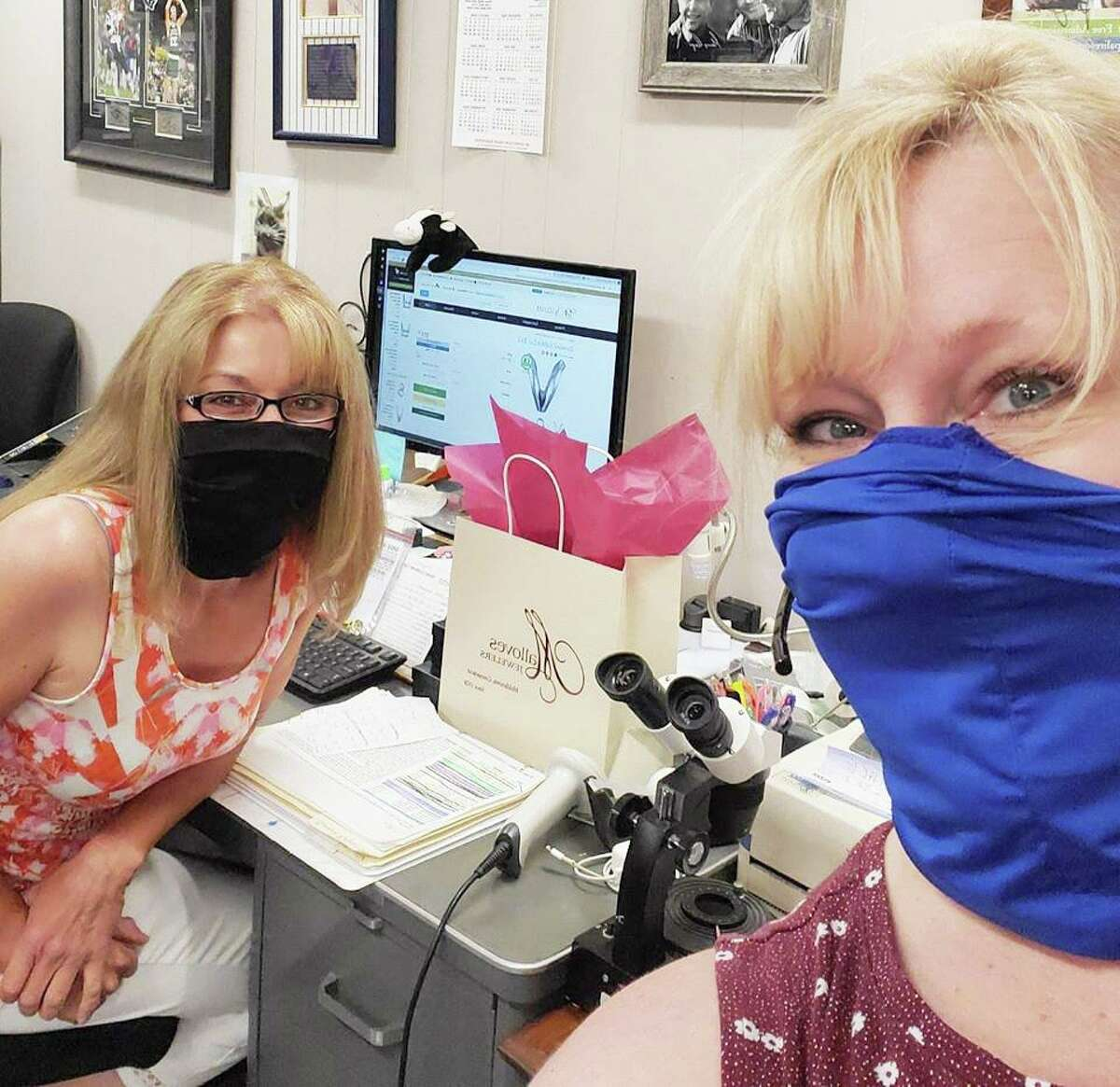 Employees of Malloves Jewelers, at 404 Main St., Middletown, invite customers to the store, now open for reduced hours due to the COVID-19 outbreak. Staff are wearing masks and cleaning every piece of jewelry tried on by customers after they're done, among other safety measures.