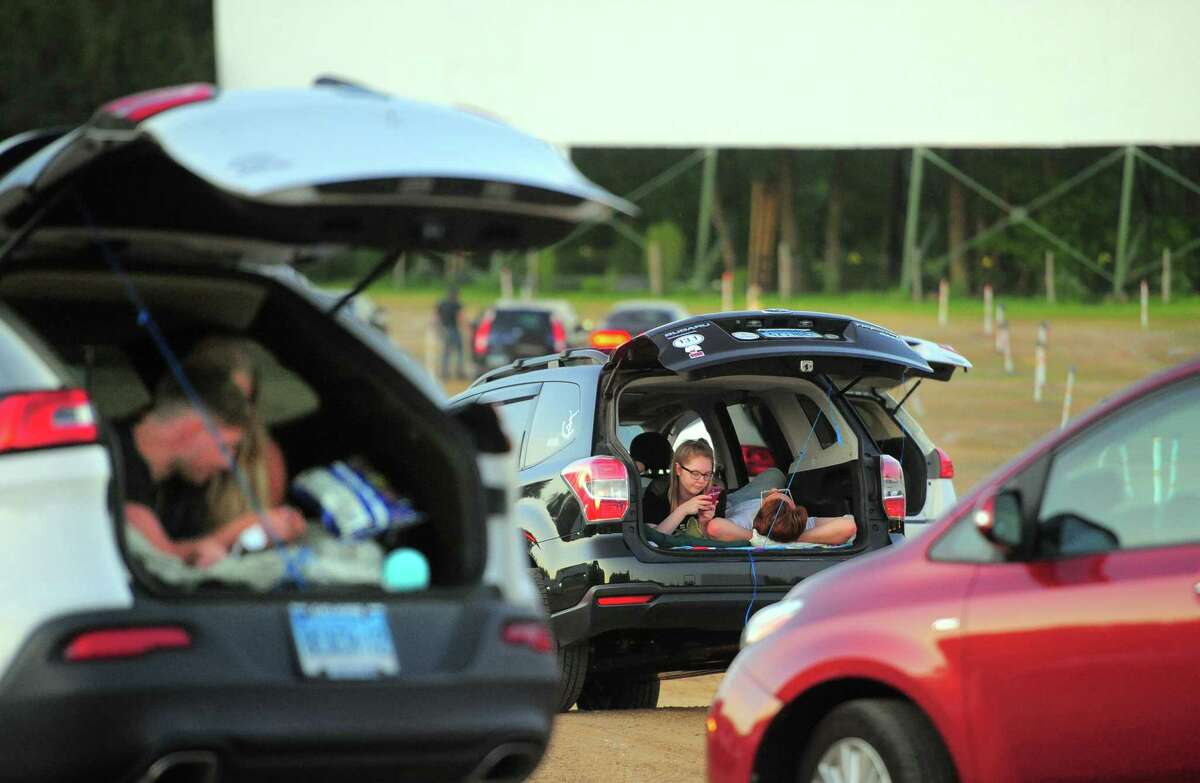 Patrons enjoy movies offered on three screens at Mansfield Drive-In Movie Theater in Mansfield, Conn., on Tuesday May 26, 2020.