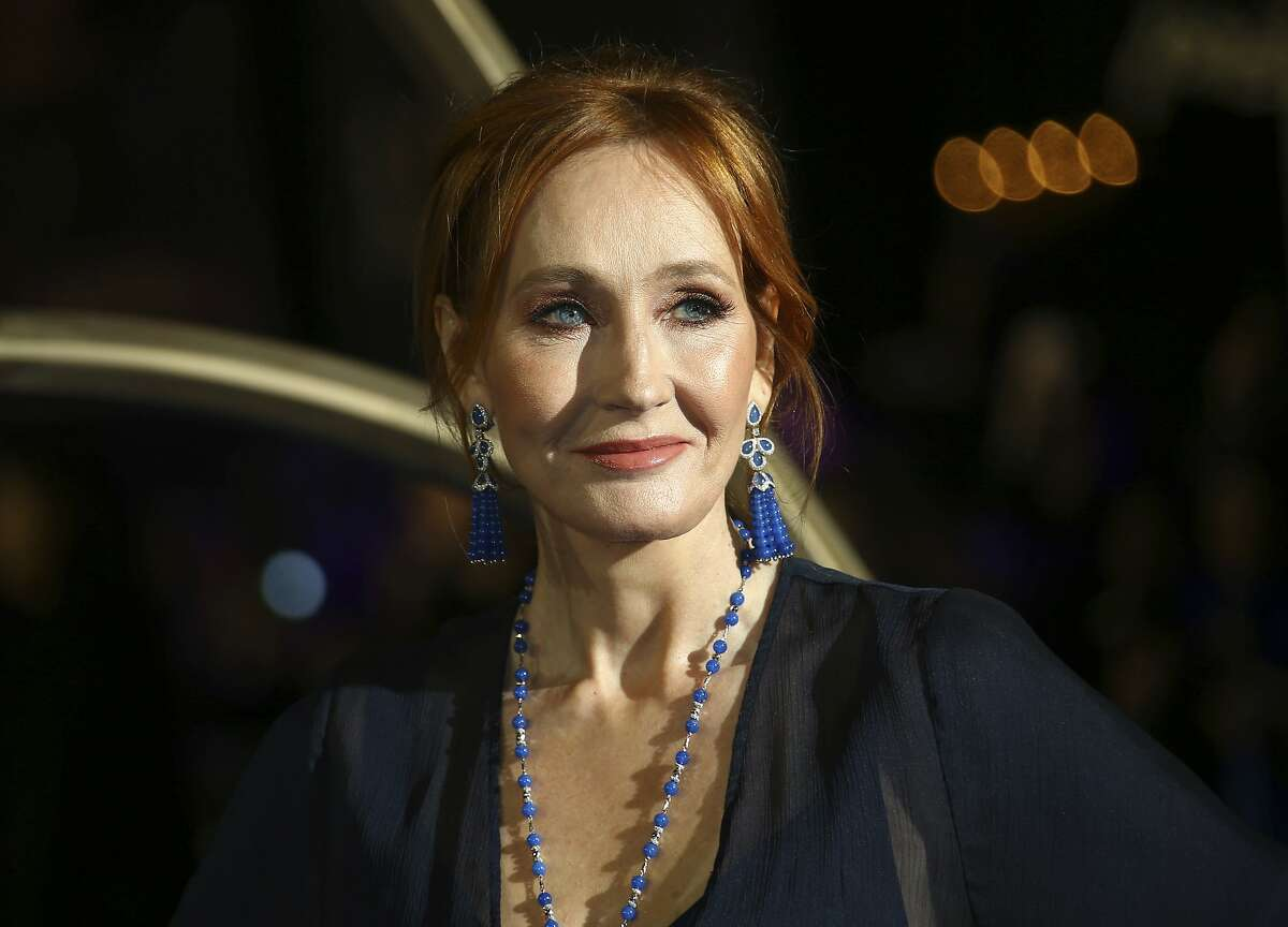 FILE - In this Nov. 13, 2018 file photo, author J.K. Rowling poses for photographers upon her arrival at the premiere of the film 'Fantastic Beasts: The Crimes of Grindelwald', in London. JK Rowling is publishing a new story called